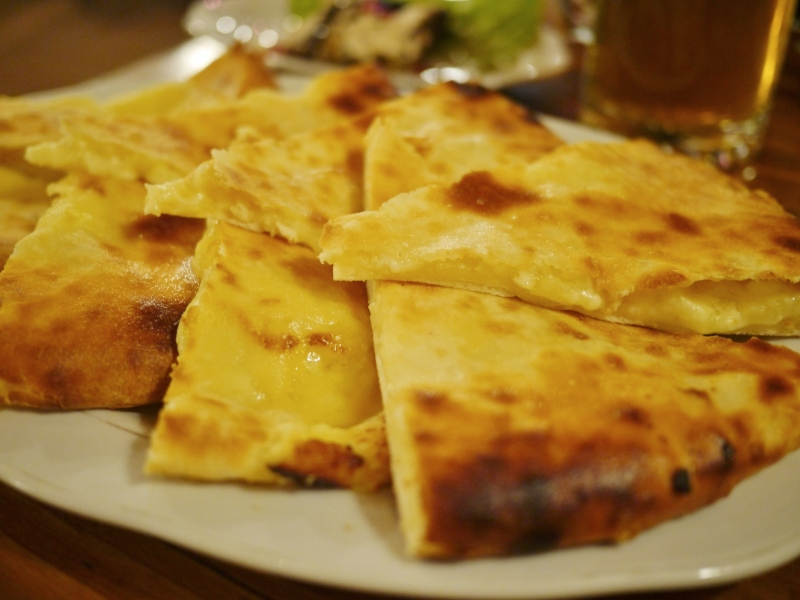 This is Ossetian khachapuri, which looks a lot like Imeretian but has an additional filling of potato.  Tasty.